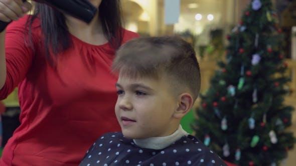 Thumbnail for Hairdresser Using Hairdryer in Barber's