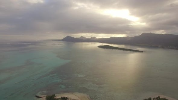 Thumbnail for Aerial Waterscape with Ocean and Distant Mountains Mauritius Island