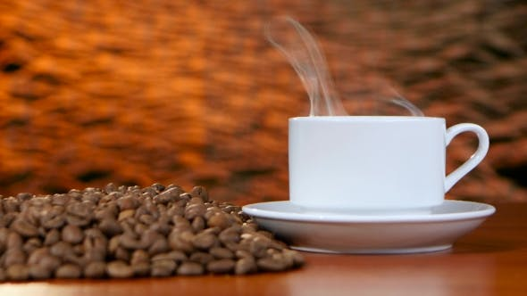 Thumbnail for Cup on a White Saucer of Hot Coffee on the Aroma Spreads Room