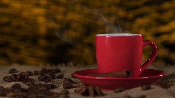 Thumbnail for Cup of Coffee with Cinnamon and Beans Scattered on the Table