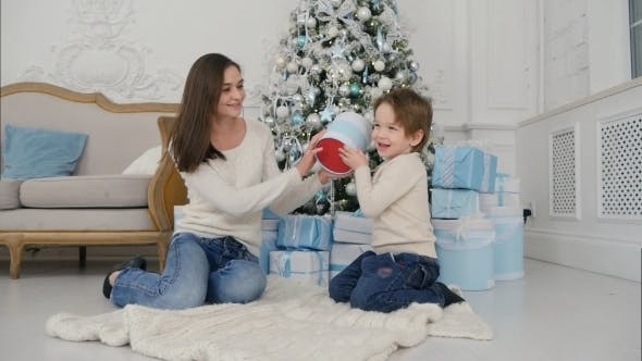 Thumbnail for Mother and Happy Son Checking Gifts Sitting Near the Christmas Tree