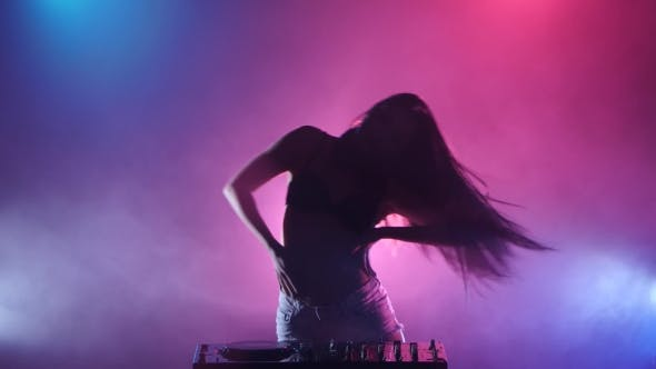 Thumbnail for Girl DJ Starts Dancing Blue Pink Lights and a Lot of Smoke
