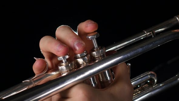 Thumbnail for Musician Playing Trumpet on a Black Background with a Spotlight