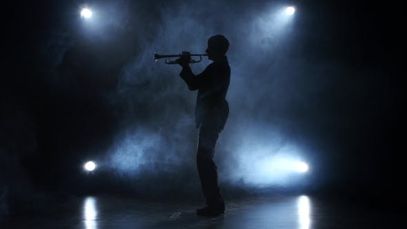 Cover Image for Trumpeter in a Smoky Studio Playing a Wind Instrument