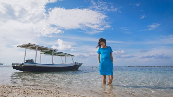 Thumbnail for The Girl in the Blue Dress on the Ocean. Against the Backdrop of Turquoise Clean Ocean Yacht and