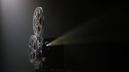 Projector Illuminated By Lights Broadcasts a Movies