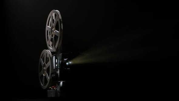 Thumbnail for Dark Studio. Projector Illuminated By Lights Broadcasts a Movies