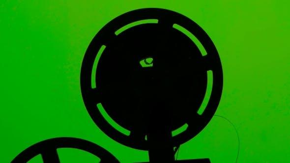 Kassetten-Projektorfolie rotiert im Rahmen. Studio Green Screen
