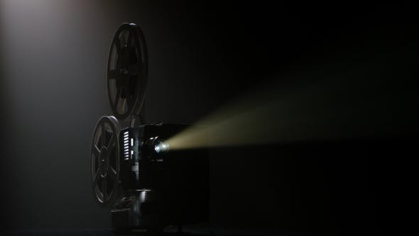 Thumbnail for Dark Movie Theater. Projector Illuminated By Lights Broadcasts a Movies