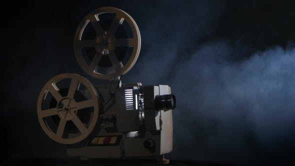 Thumbnail for Projector Displays Movies in the Smoke. Black Background