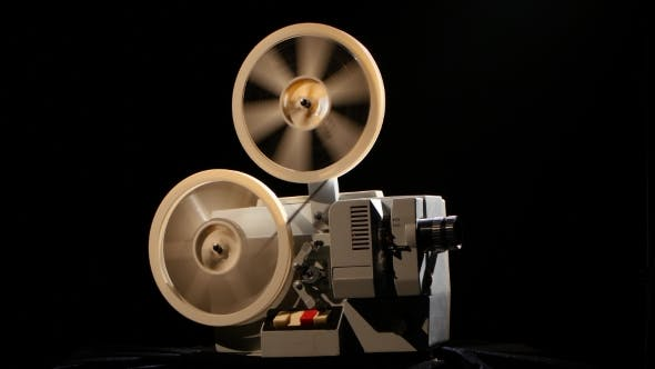 Thumbnail for Projector. Rewinding the Film From One the Reel To Another