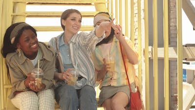 Three Girlfriends Chatting on Sunny Day