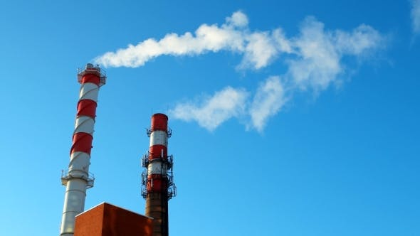 Thumbnail for Boiler House Chimney. Steam Against the Clear Blue Sky. Industrial Zone of the City