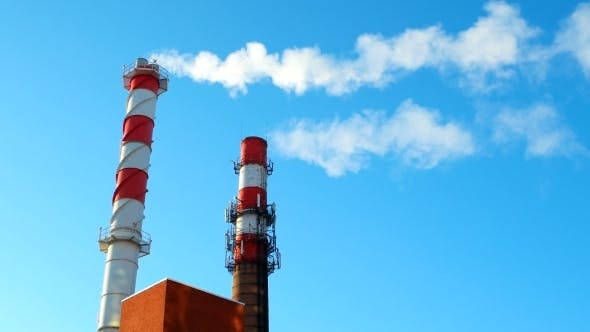 Thumbnail for Boiler House Chimney. Steam Against the Clear Blue Sky. Industrial Zone of the City.