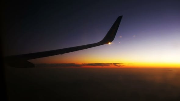 Thumbnail for Passenger Plane in Flight Against a Background of Sunset