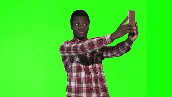 African Make Selfie on Green Screen