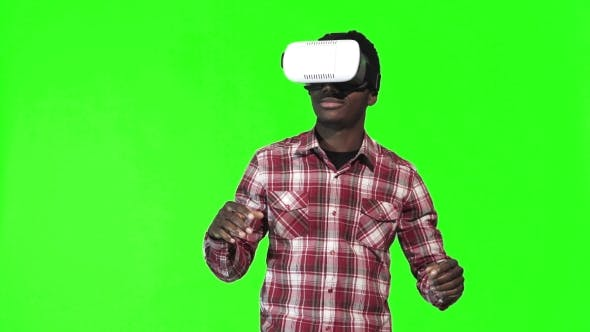 Thumbnail for African Man Wearing VR Googles on Green Screen