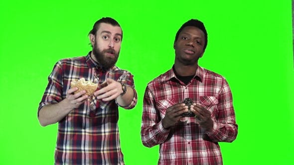 Thumbnail for Two Man Eating Burgers