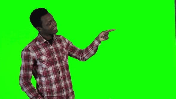 Thumbnail for African Man Pointing on Green