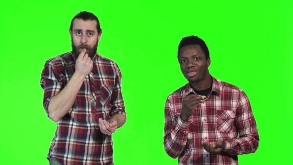 Thumbnail for Two Men Eating French Fries on Green Screen