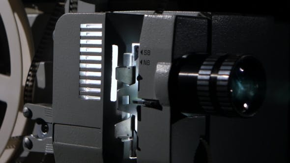 Thumbnail for Movie Projector That Turns the Film Reel. Side View