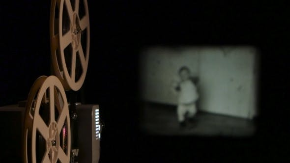 Thumbnail for Vintage Projector Translates Old Film on the Screen.