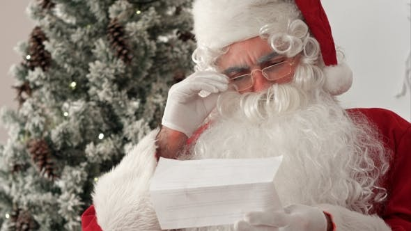 Thumbnail for Santa Claus Opening an Envelope and Reading a Letter