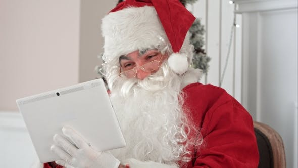 Thumbnail for Joyful Santa Claus Checking Up Christmas Emails From Children on His Digital Tablet