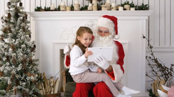 Thumbnail for Happy Little Girl Showing Surprised Santa Presents on Tablet