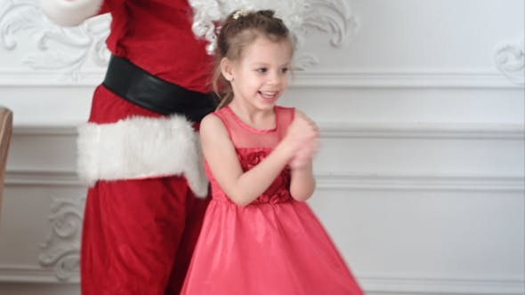 Thumbnail for Pretty Little Girl Dancing Together with Santa Claus