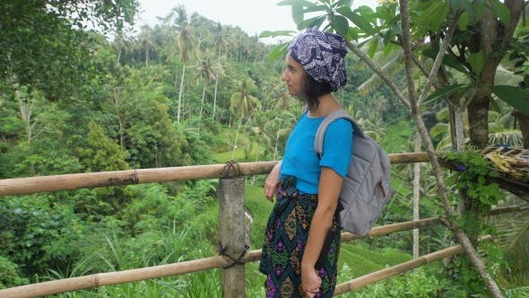 Thumbnail for European Female Tourist Standing on Terrace Looking Luxuriant Tropical Vegetation Around. Young Girl