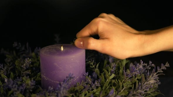 Thumbnail for Woman's Hand Lights a Violet Candle with a Lighter