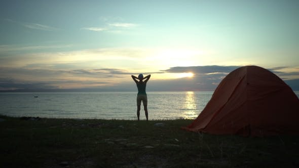 Thumbnail for Woman at the Camping Looking at Sunrise in the Morning