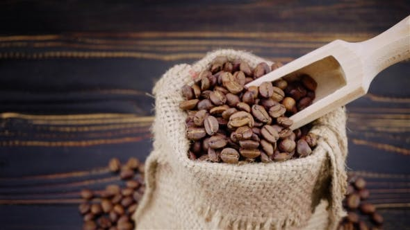 Cover Image for Roasted Coffee Beans on Wooden Background