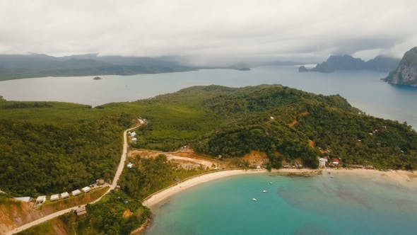 Cover Image for The Beautiful Bay with Mountains Rocks Aerial View. Tropical Islands.