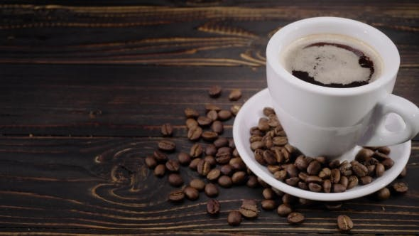 Thumbnail for Cup of Coffee and Roasted Beans on Wooden Background