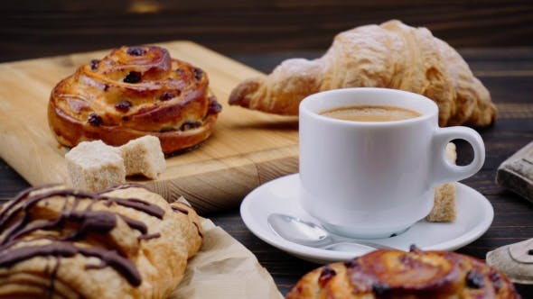 Thumbnail for Cup of Coffee and Croissants on Wooden Background