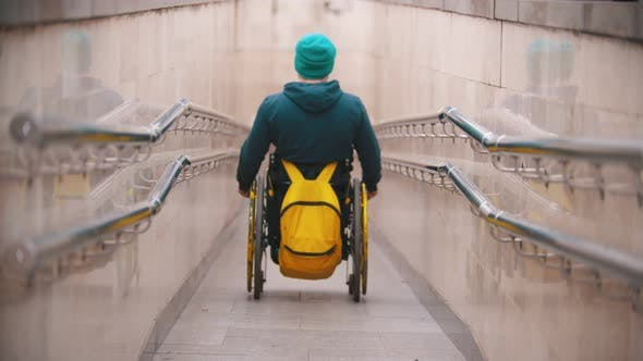 Thumbnail for Disabled Man in Wheelchair Getting Down the Long Special Ramp