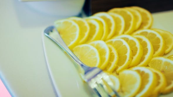 Thumbnail for Sliced Lemon on Plate