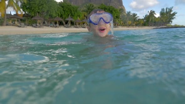 Thumbnail for View of Small Boy Swimming in the Indian Ocean in the Snorkeling Mask and Take a Picture