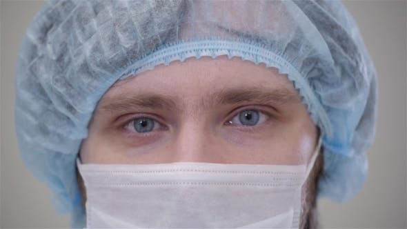 Thumbnail for Handsome Surgeon in Mask Is Looking at Camera