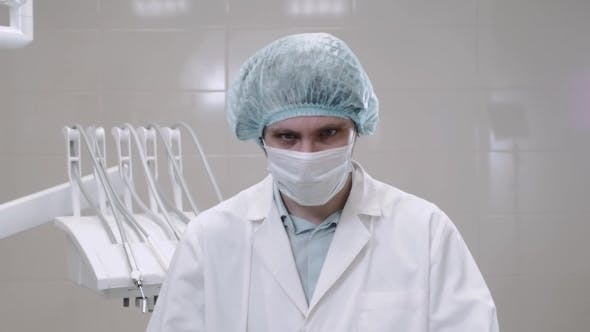 Thumbnail for Portrait of Doctor in Mask and White Uniform Wearing Glasses in Modern Hospital