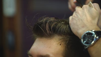 Haircut at Barber Shop with Scissors