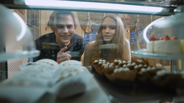 Thumbnail for Beautiful Couple of Young People in a Candy Store