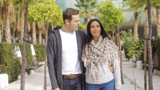 Cover Image for Trendy Young Couple Walking Along a Promenade