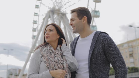 Thumbnail for Young Couple Standing in Front of a Ferris Wheel