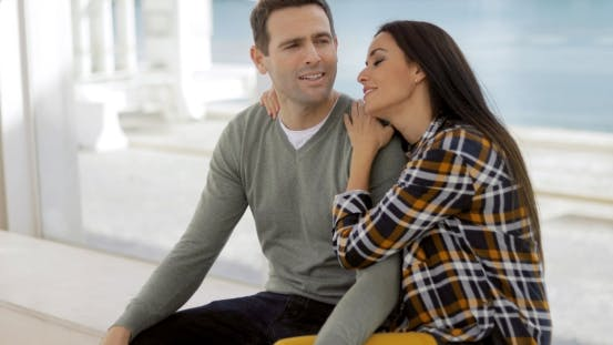 Cover Image for Romantic Young Couple Sitting Watching