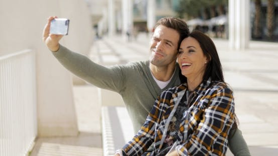 Thumbnail for Happy Laughing Couple Taking Their Selfie