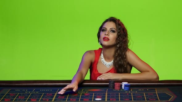 Thumbnail for Beautiful Girl Sitting at the Poker Table in a Casino