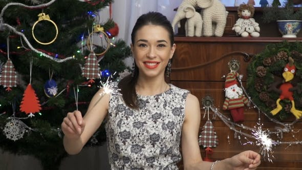 Thumbnail for Woman Dancing with the Sparkles in a Christmas Party